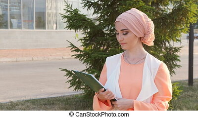 Muslim woman standing with document paper