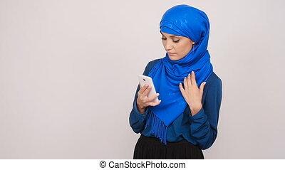 Muslim woman taking selfie - Arabian muslim woman taking...