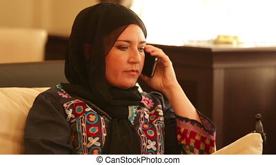 Muslim woman talking on the phone