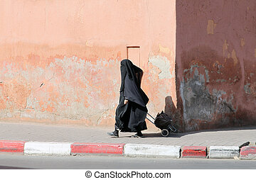 Muslim woman walking down the street