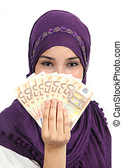 Muslim woman wearing a hijab holding a lot of money