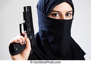 Muslim woman with a gun