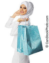 Muslim woman with bags