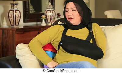 Muslim woman with injured arm