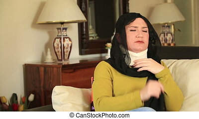 Muslim woman with neck brace