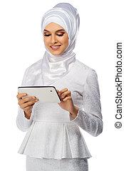 Muslim woman with tablet PC