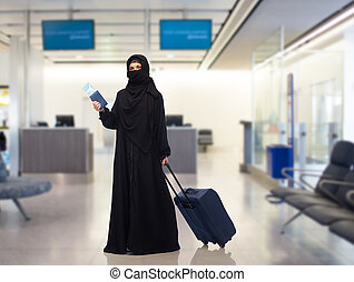 muslim woman with ticket, passport and travel bag - travel,...