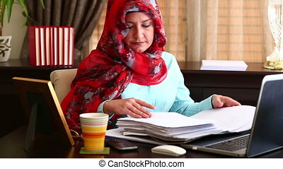 Muslim Woman Working in Office