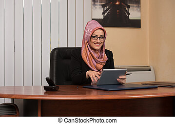 Muslim Woman Working On Computer In Office