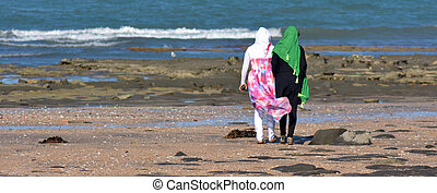 Muslim women - AUCKLAND, NZL - JAN 25 2015:Two muslim women...