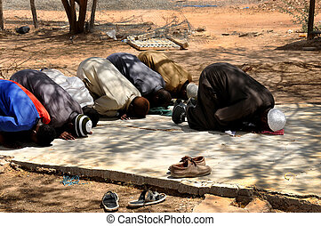 Muslims praying in congregation outside, islamic Prayer -...