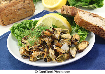 a plate of marinated mussels and dill