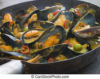 Mussels Cooked Bangladeshi Rezala Style - Pan of Mussels...