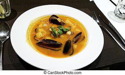 Mussels cream spanish soup.