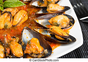 Mussels fry - Fried mussels in a sauce of fresh tomatoes