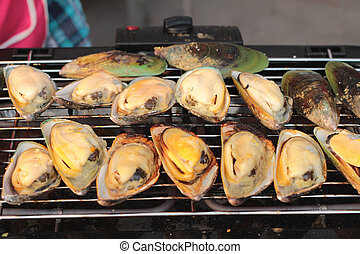 Mussels grilled on a barbecue grill.