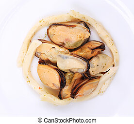 Mussels in a white plate. Isolated on a white background.
