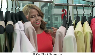 Fashionista choosing dress in boutique