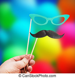 mustache and glasses of paper in his hand on a stick...