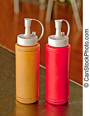 Mustard and ketchup bottle on dining table