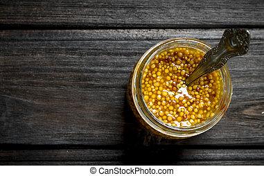 Mustard in a glass jar.