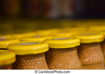 Mustard jars in the store.