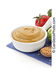 mustard sauce in bowl on white