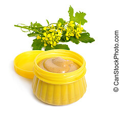 Mustard sauce with flowers. Isolated on white background