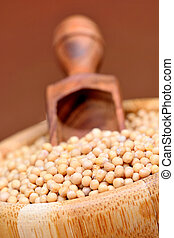 Mustard seeds in a bamboo bowl