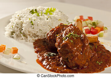 Mutton Curry - Spicy mutton masala with rice.