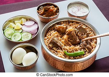Mutton/Lamb biryani with sides - Closeup view from the top...