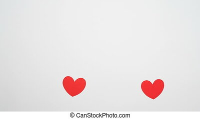 mutual love of two red paper hearts, isolated on white