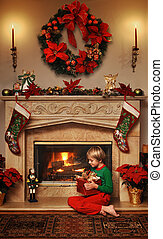 My Christmas gift - 8 year old boy sitting beside the fire ...