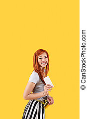 Nice positive woman holding her smartphone