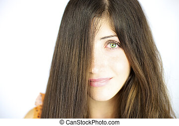 Smiling beauty with long straightened hair and wavy hair