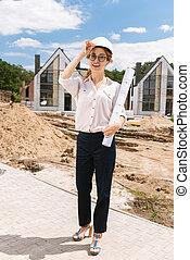 Professional female architect smiling