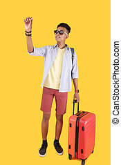 Nice young man holding his suitcase