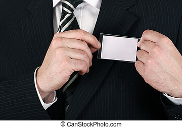 Business man adjusting his nametag - insert your own brand and iniformation