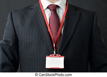 my name is - man in suit showing id or name badge