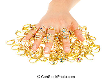 A woman's hand wearing a lot of golden rings covering a bulk of rings