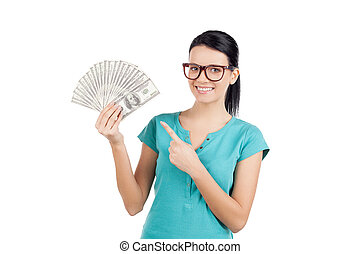My savings. Cheerful young woman in glasses holding money and pointing them while standing isolated on white