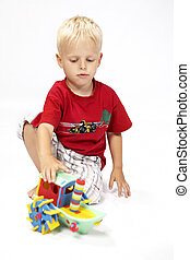My steam boat - Children at play with color foam toys in...