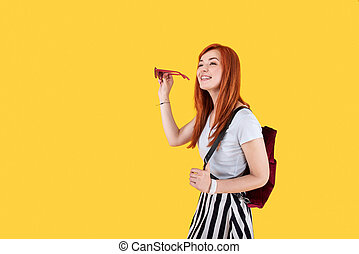 Cheerful happy woman doing sightseeing