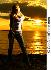 my vacation - beautiful young girl portrait on golden sunset