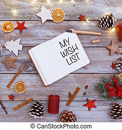 My Wish List text in note pad on christmas flat lay