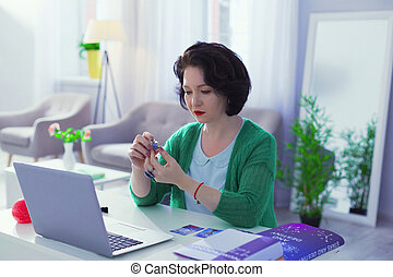 Nice good looking woman sitting at the laptop