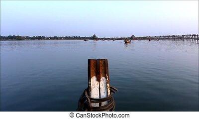 A boat moving on Amarapura lake Mandalay Myanmar. handheld record on boat
