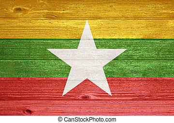 Myanmar Flag painted on old wood plank background.