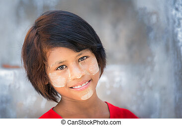 Myanmar girl with cosmetic power on her face