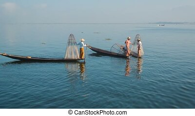 Myanmar, Inle Lake. Fishermen on vintage boats